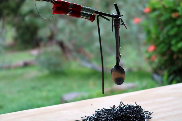 DIY tent peg electromagnet lifting tacks, a spoon and a smaller tent peg