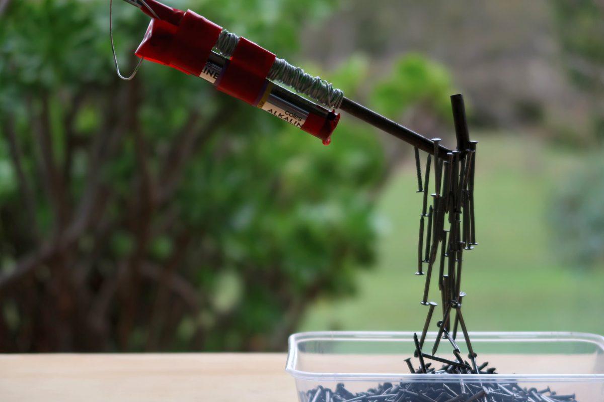 DIY tent peg electromagnet lifting tacks from a box