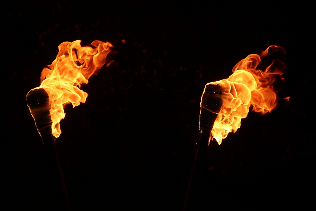 close up of DIY fire torches burning brightly at night